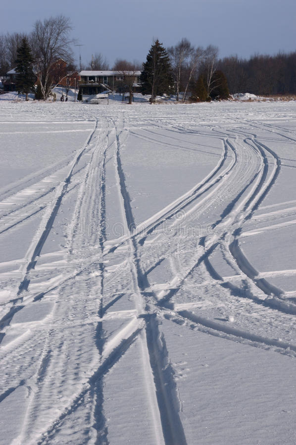 Download Snowmobile Tracks In Snow During Winter Royalty Free Stock Photos - Image: 17614118