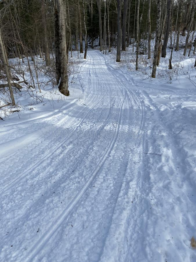 Snowmobile trail in Adirondack forest stock photos