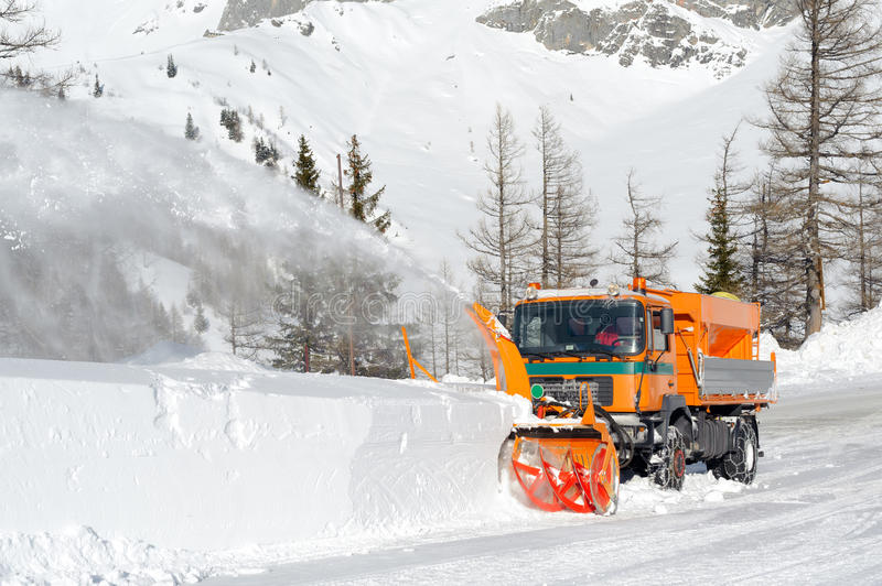 Snowplow. Removing snow from intercity road from snow blizzard stock photos