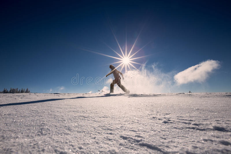 Snowshoeing in fresh snow in Black Forest, Germany. Man snowshoeing in fresh snow in Black Forest, Germany stock photo