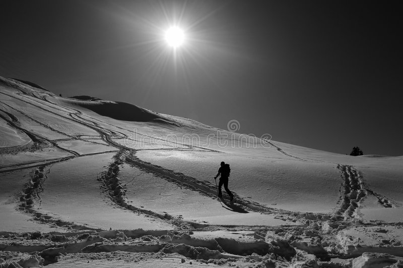 Snowshoeing man stock images