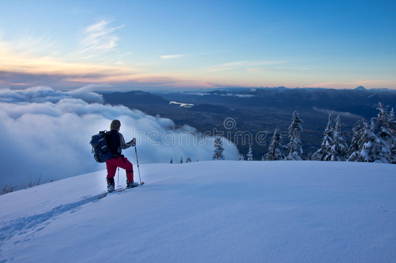 Snowshoers at viewpoint stock photos