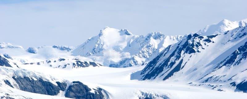 Snowy Alaska mountains. Snowy mountain tops in Alaska royalty free stock images
