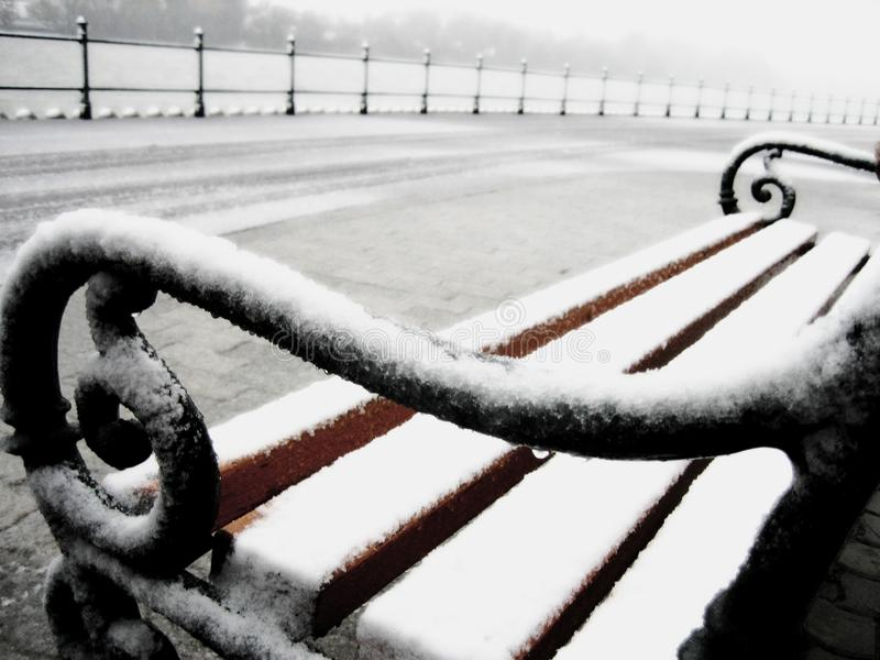 Snowy bench detail. Close-up image of a snowy bench taken in Dunakeszi, Hungary, by the Danube stock photo