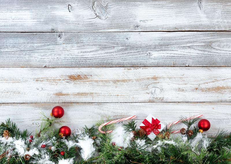 Snowy bottom border of Christmas evergreen branches with other h stock image