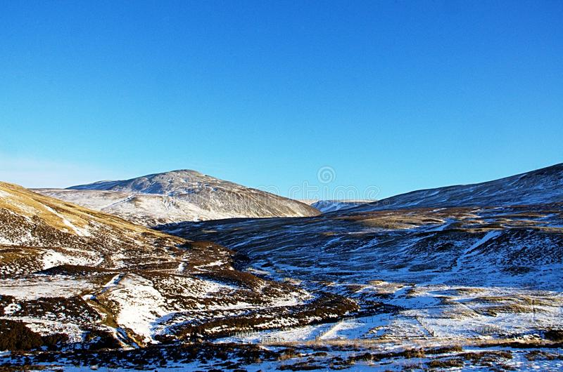 Snowy cairngorm mountains stock photo