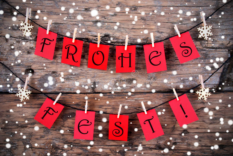 Snowy Christmas Background with the Words Frohes Fest. Snowy Christmas Background with the German Words Frohes Fest, which means Merry Christmas, on Red Tags stock image