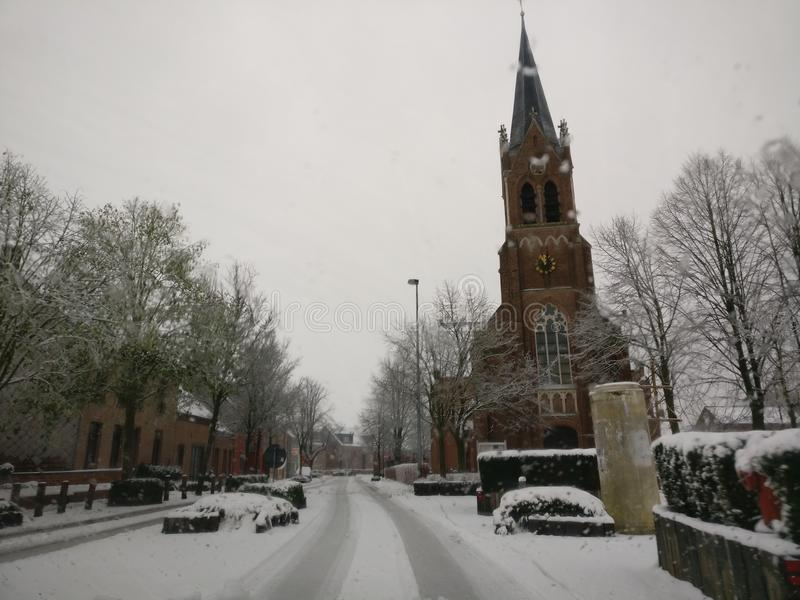Snowy church stock images