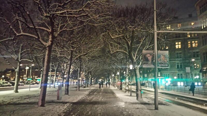 Snowy city streets at night stock photo