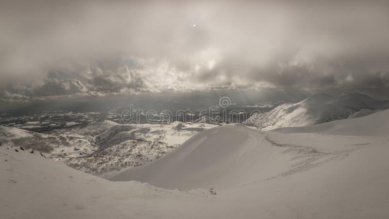 Snowy cloudy mountain scenery near Goshiki Onsen royalty free stock images