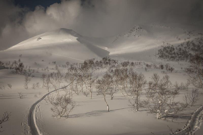 Snowy cloudy mountain scenery near Goshiki Onsen royalty free stock photo