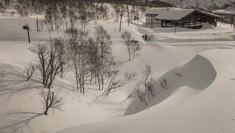 Snowy cloudy mountain scenery near Goshiki Onsen royalty free stock photography