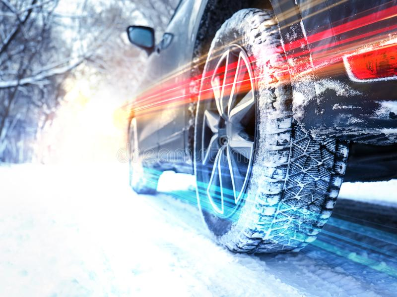 Snowy country road with car on winter day, closeup. Space for text royalty free stock photo