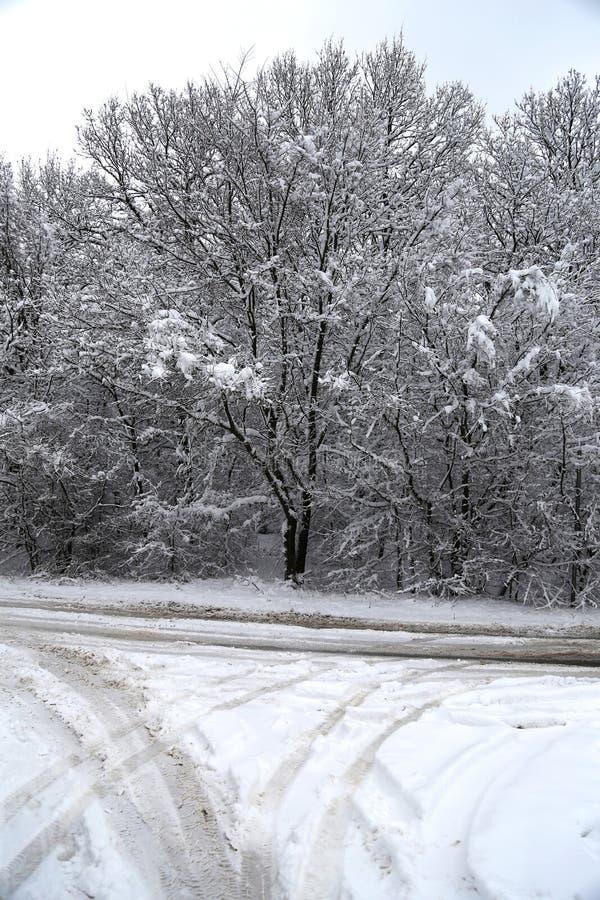 Empty country crossroad when the snow fallen rural environment stock photos