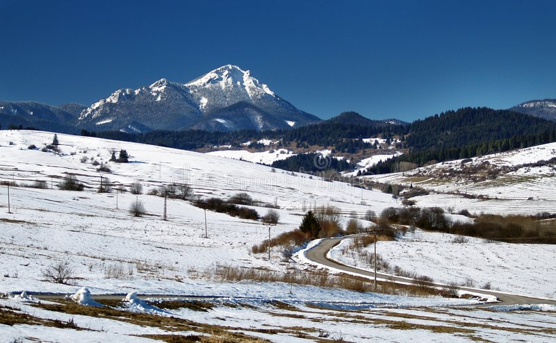 Snowy countryside and mountain. Scenic view of snowy countryside with mountains in background, Liptov region, Slovakia stock photography