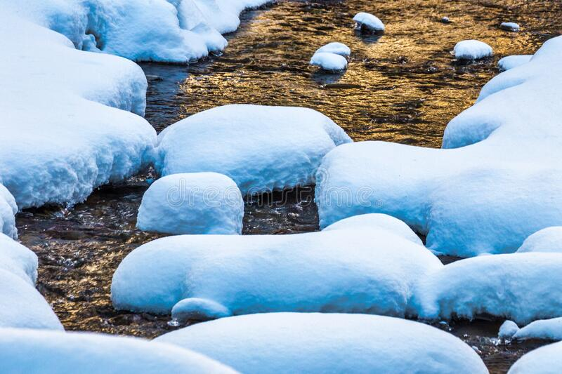 Snowy creek in winter. At sunset royalty free stock image