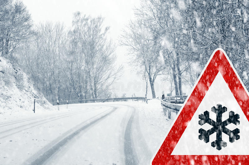 Download Snowy Curvy Road With Traffic Sign Stock Photo - Image: 34492586