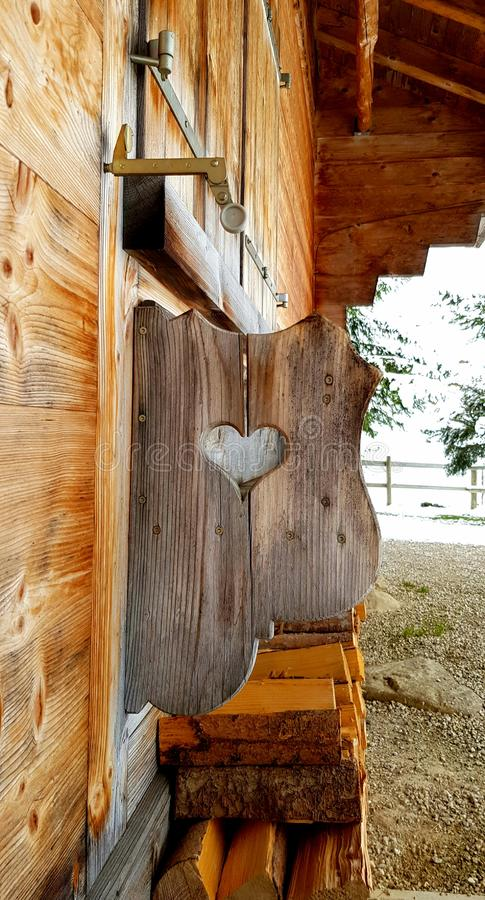 Chalet in winter, wooden walls and heart. royalty free stock photography