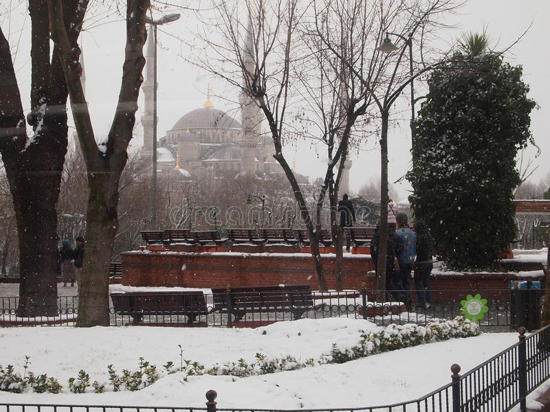 Snowy day in Istanbul. Istanbul, Turkey - January 2012 : Snowy day in Istanbul, around Sultanahmet area with Blue Mosque as the background. Zero degrees Celcius stock image