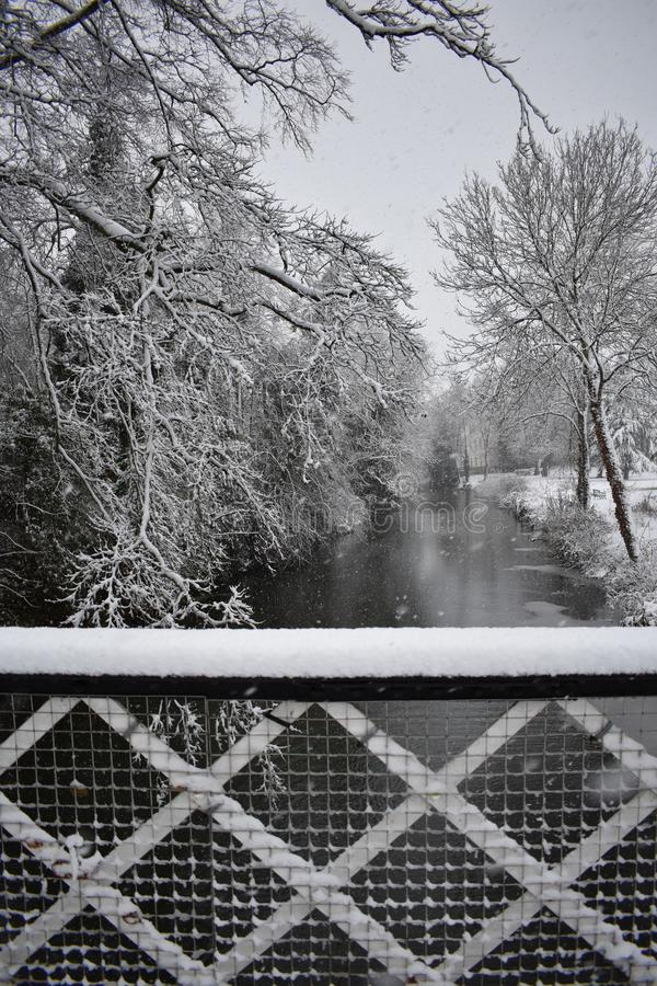 Snowy day in Leamington Spa UK, view over the Leam River, Pump Room Gardens - 10 december 2017. Photo taken in Pump Room Gardens in central Leamington Spa, UK stock image