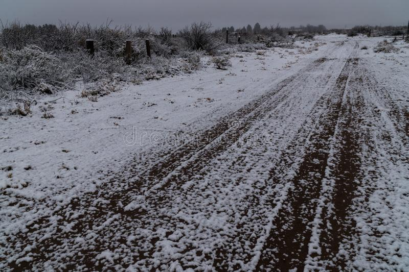 Snowy desert winter road in the southwest. A snowy desert winter dirt road in southwest New Mexico near the town of Deming royalty free stock image