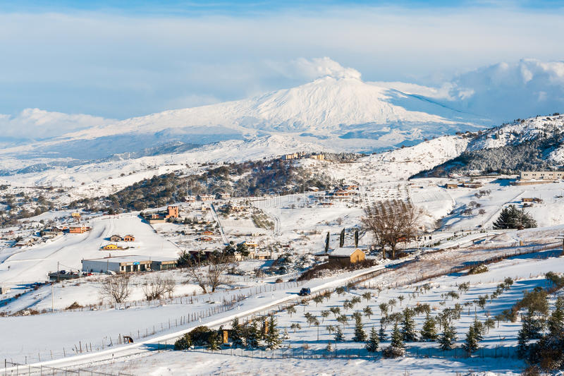Snowy Etna. Snowy landscape with the Etna volcano in the background stock photo