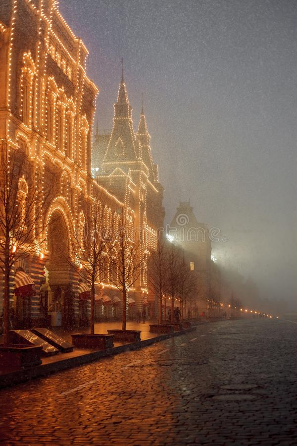 Snowy evening in Moscow. Red square and GUM royalty free stock images