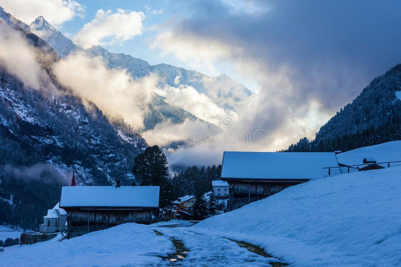 Snowy farm houses at the blue hour royalty free stock image