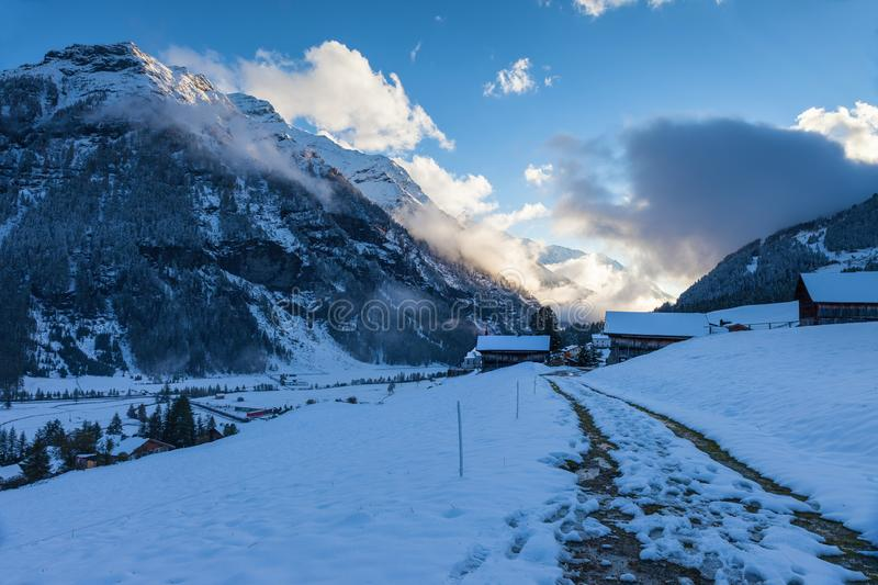 Snowy farm houses at the blue hour royalty free stock photography