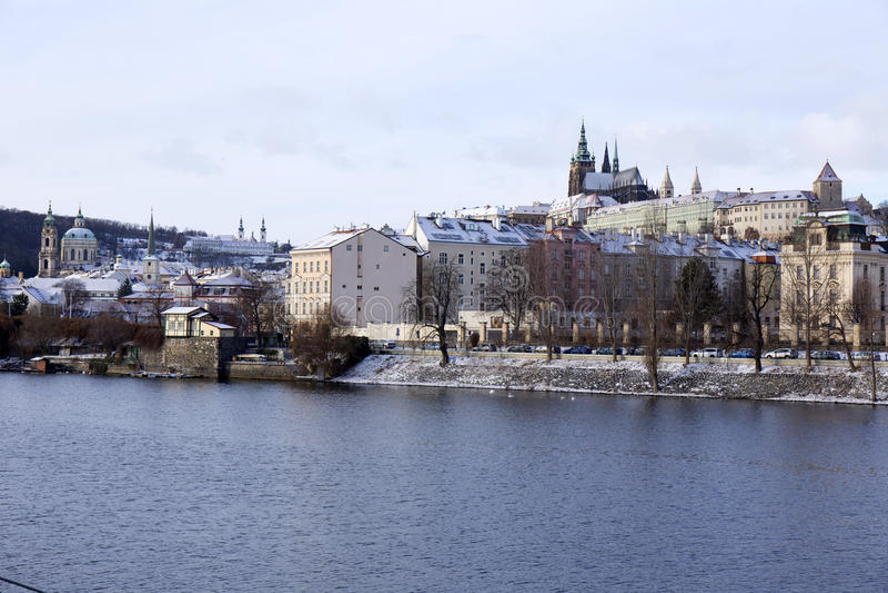 Download Snowy Freeze Prague Lesser Town With Gothic Castle Above River Vltava, Czech Republic Stock Photo - Image: 83701129