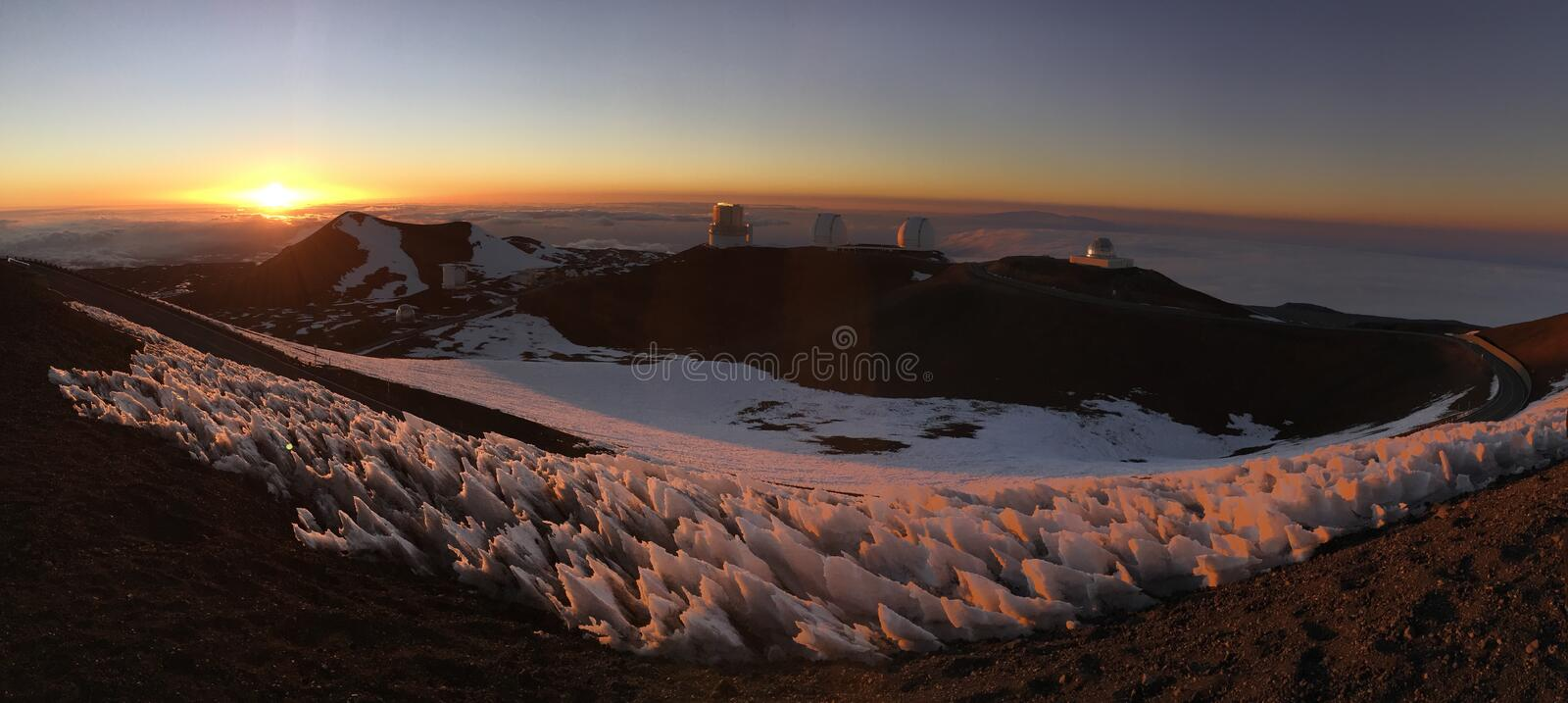 Snowy Hawaiian Sunset above the Clouds royalty free stock photos