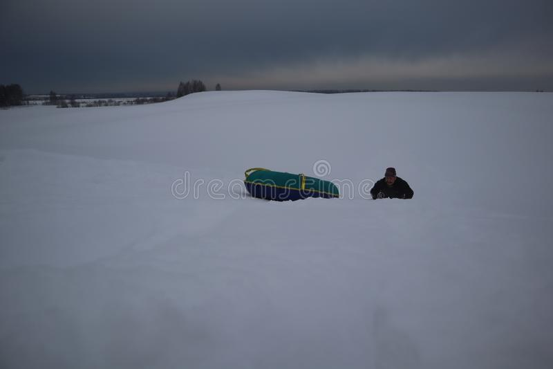 Snow tubing. sleigh on the top of the hill. winter activity concept stock photography