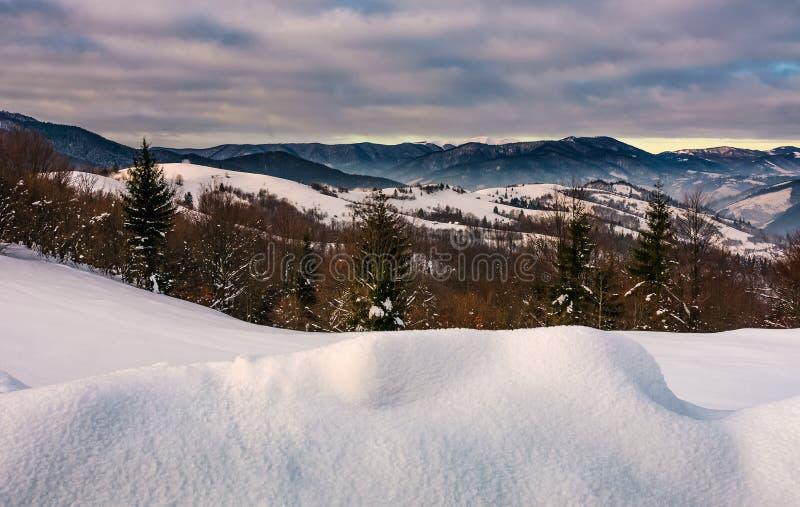 Snowy hillsides in mountainous countryside stock photo