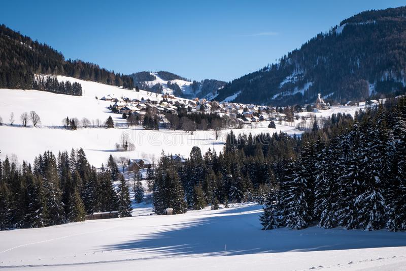 Snowy holiday resort Hohentauern in a sunny day in Styria. Snow covered holiday resort Hohentauern in a sunny day in Styria, Austria royalty free stock photography