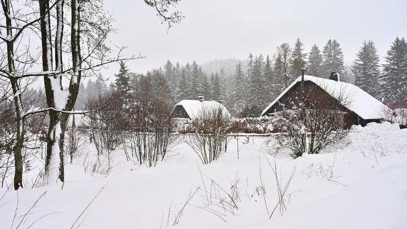 Snowy house. A beautiful winter landscape concept with a building and snow.  royalty free stock image