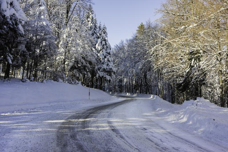 A snowy and icy road in the Vosges mountains France royalty free stock photos