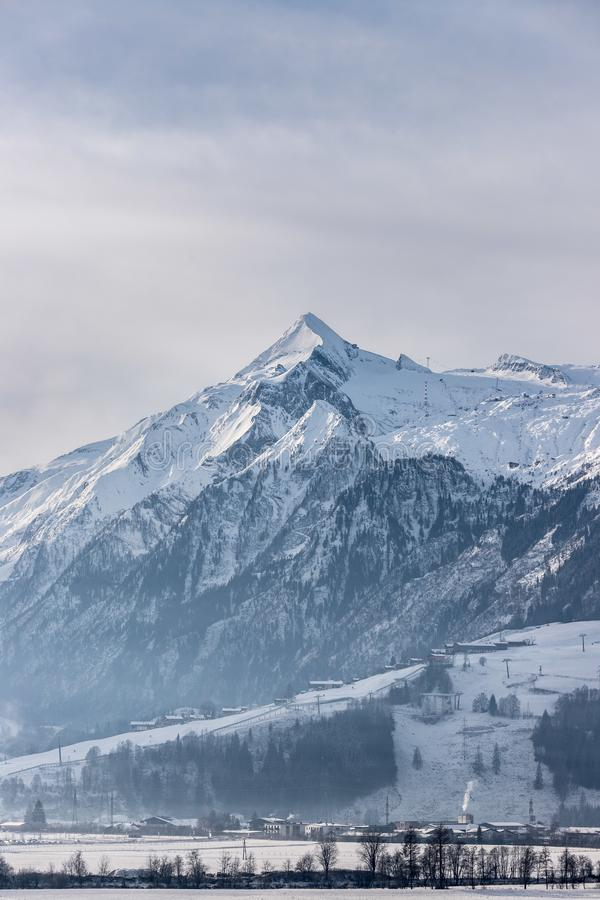Snowy Kitzsteinhorn in winter, ski lift, Austria stock photography