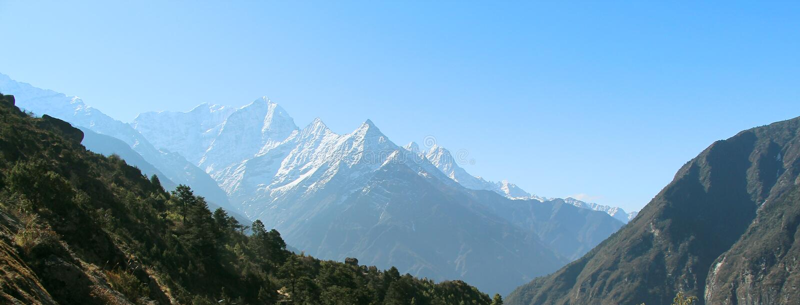 Snowy Kusum Kanguru mountain peaks in Himalayas stock photos