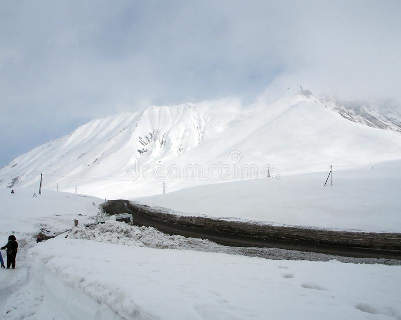 Snowy landscape along the Georgian military road in spring in the area of The cross pass royalty free stock photo