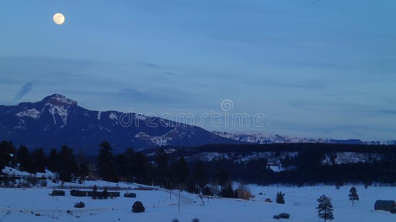 Full Moon Over the Mountains in Winter royalty free stock photo