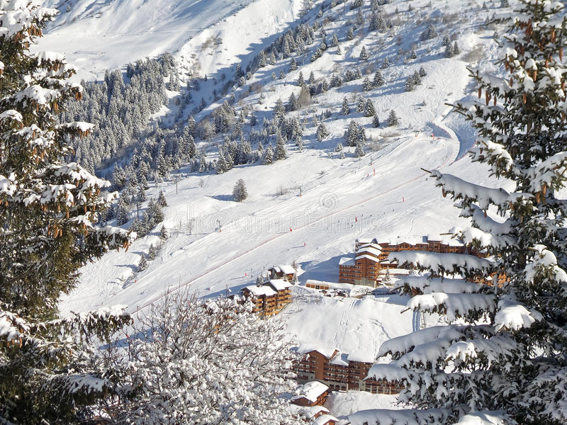 Snowy landscape with ski chalets, Meribel, the Alps stock images