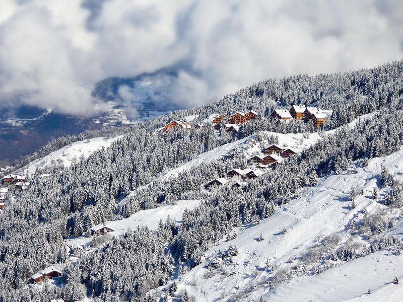 Snowy landscape with ski chalets, Meribel, the Alps. France royalty free stock images