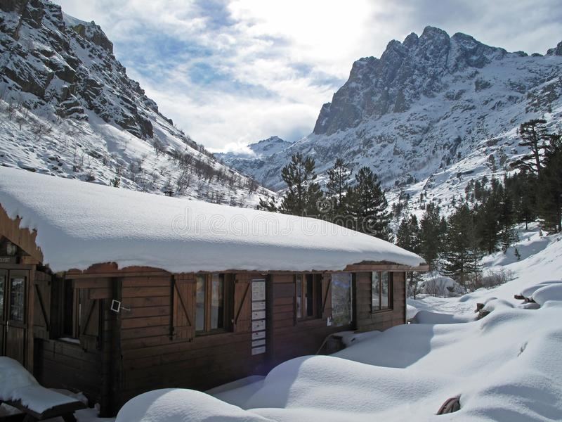 Snowy lansdscape with mountain hut in winter, Corsica, France, Europe stock photo