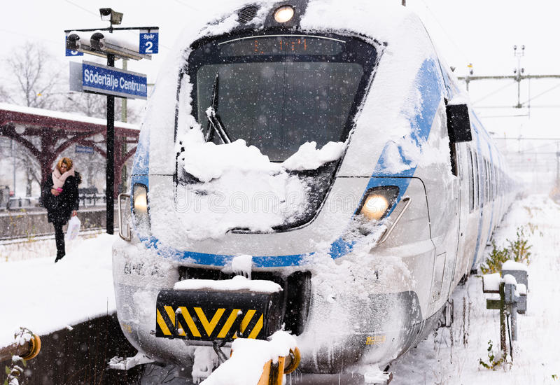 Snowy local train has arrived at its final destination on a winter day royalty free stock photos