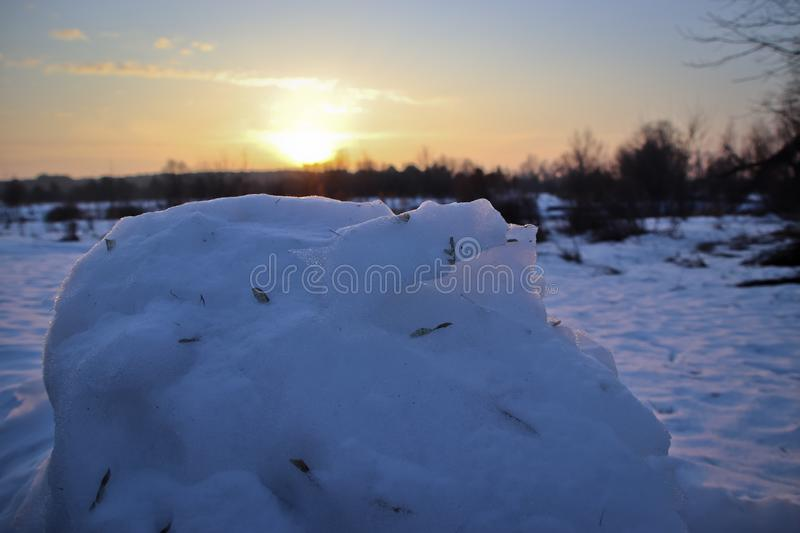 Snowy mass in the winter evening at dawn stock photo