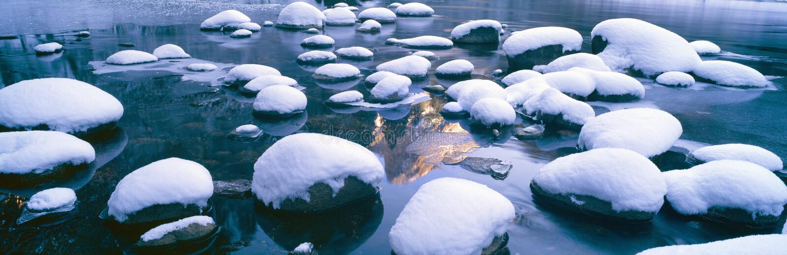Snowy Merced River with reflection of Half Dome, Yosemite, California royalty free stock photography
