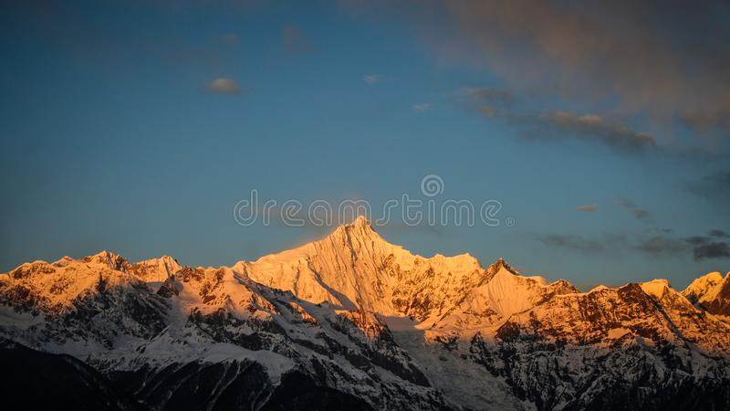 Snowy Mountain during Golden Hour royalty free stock photos