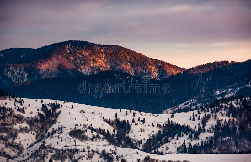 Snowy mountain hills at sunrise royalty free stock photos