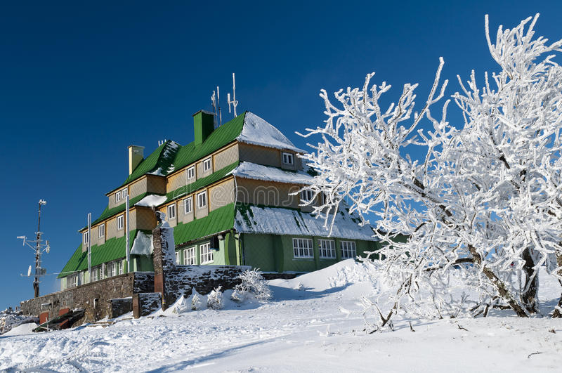 Snowy mountain hut royalty free stock photography