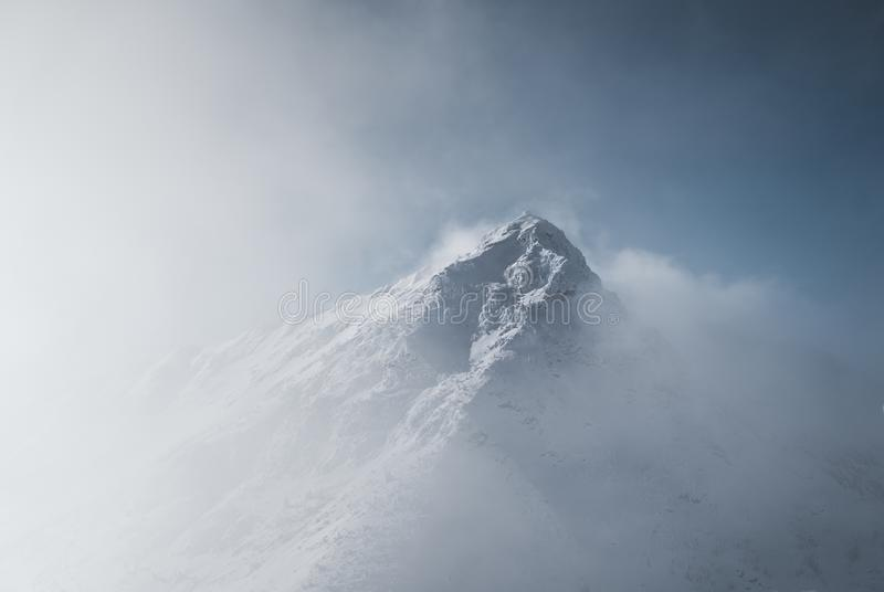 Snowy mountain landscape in cloudy weather near Rossland Range.  royalty free stock photography